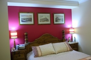 Walls are Spanish Cream and feature wall uses Deep Red from the Dulux Colour Range.The ceiling used the normal vivid white for the first coat and the pink-to-white for the second coat.